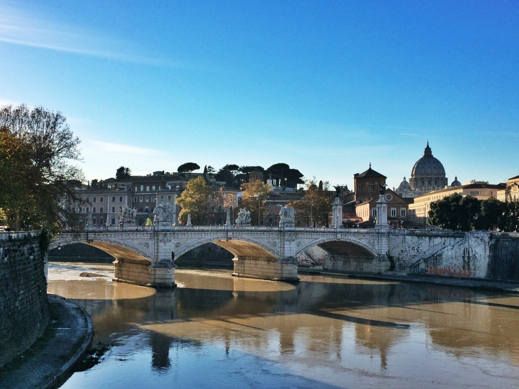 Peaceful view of the Tiber River with the Vatican in the background