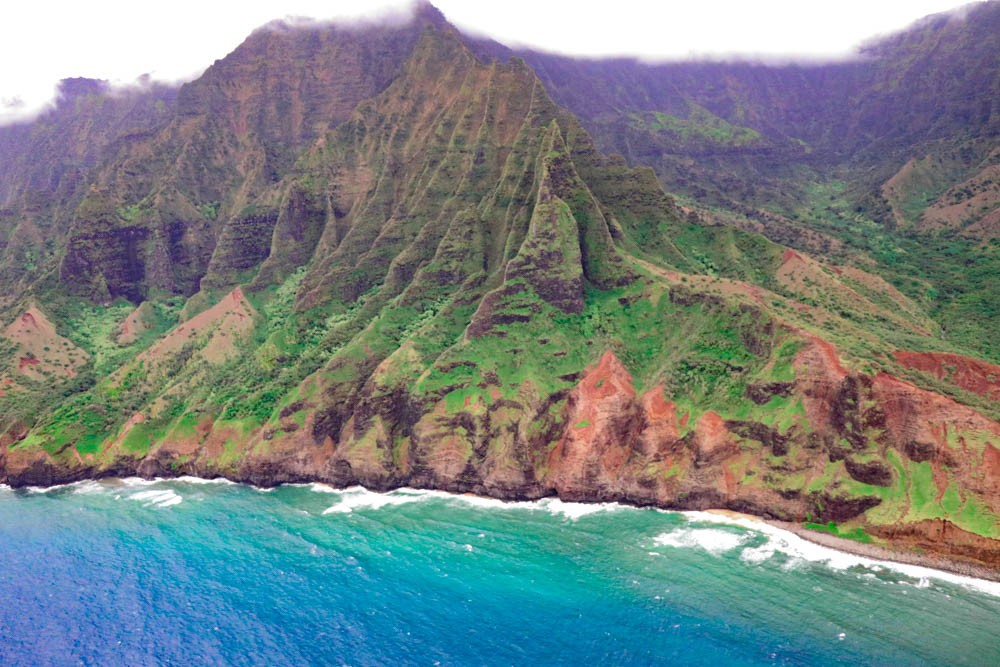 Taking Off On A Doors Off Helicopter Tour in Kauai